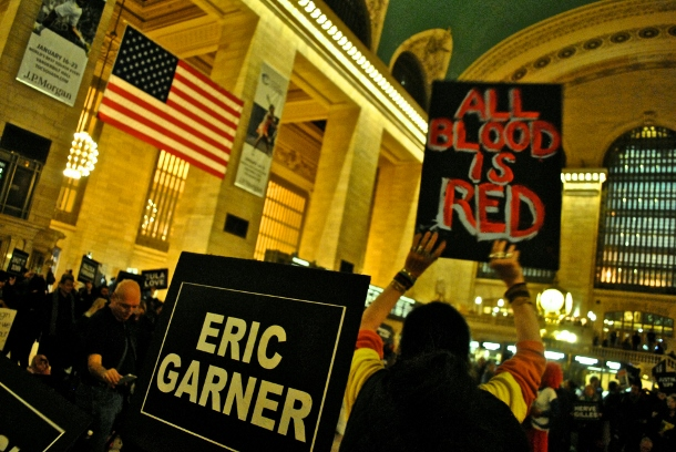 activist-holds-up-a-sign-reading-all-blood-is-read-in-grand-central-on-martin-luther-king-day-january-20-610x408